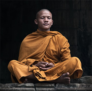 Monk meditating in a traditional style
