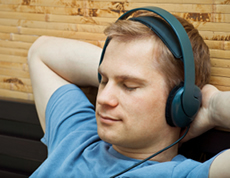 man listening to binaural beats through headphones